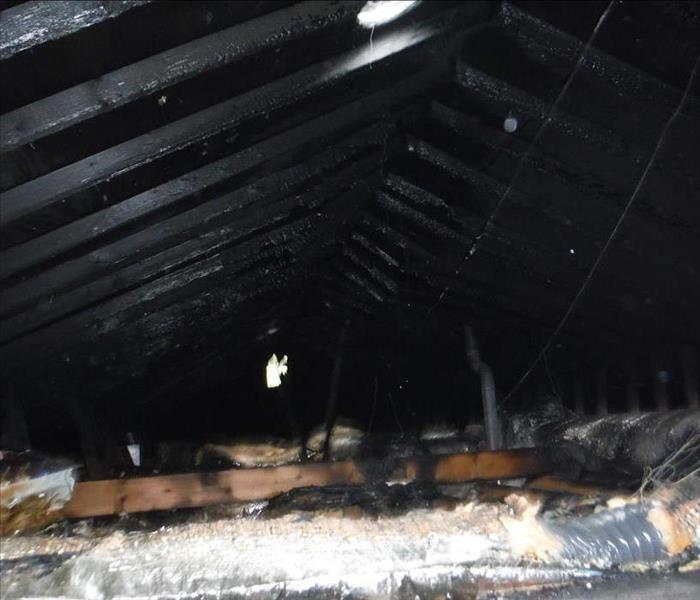 Attic fire restoration and construction put back. Before